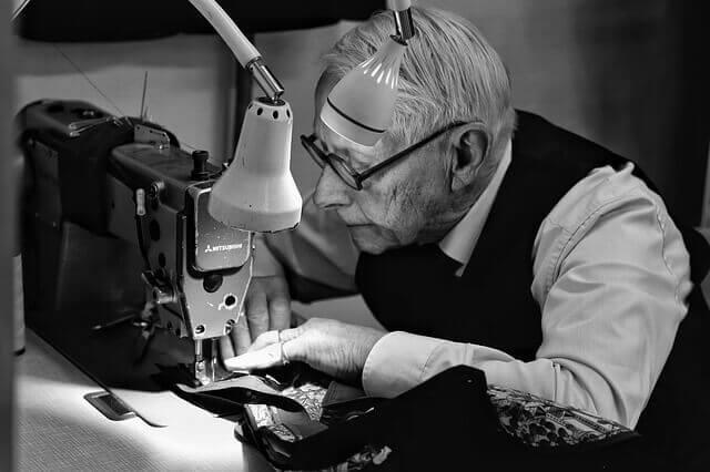 Man work sewingmachine